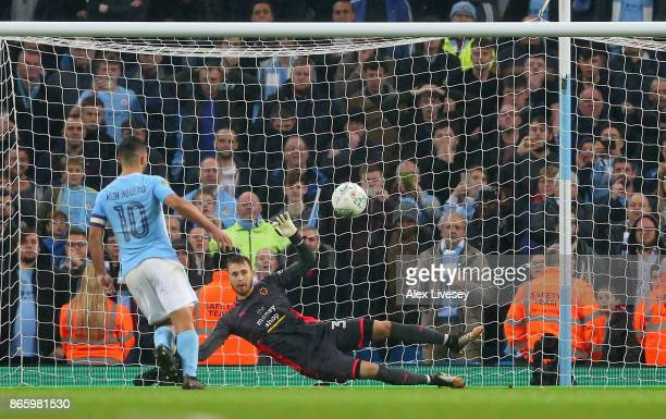 Sergio Aguero of Manchester City scores the winning penalty during the Carabao Cup Fourth Round match between Manchester City and Wolverhampton...