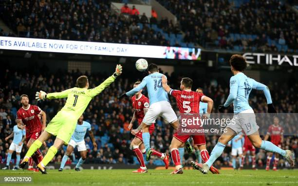 Sergio Aguero of Manchester City scores their second goal past Frank Fielding of Bristol City during the Carabao Cup SemiFinal First Leg match...