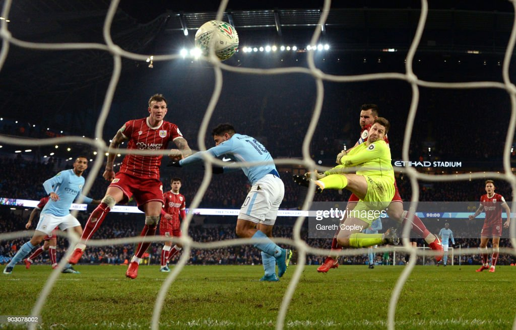 Sergio Aguero of Manchester City scores their second goal past Frank Fielding of Bristol City during the Carabao Cup Semi-Final First Leg match between Manchester City and Bristol City at Etihad Stadium on January 9, 2018 in Manchester, England.