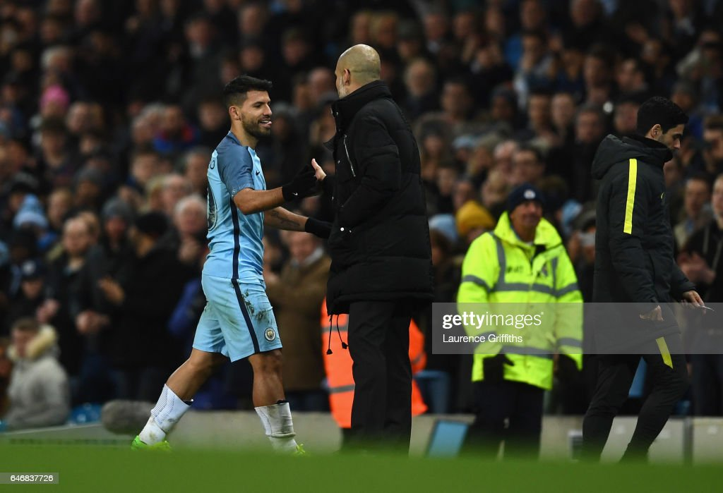 Sergio Aguero of Manchester City shakes hands with Josep Guardiola manager of Manchester City as he is substituted during The Emirates FA Cup Fifth Round Replay match between Manchester City and Huddersfield Town at Etihad Stadium on March 1, 2017 in Manchester, England.