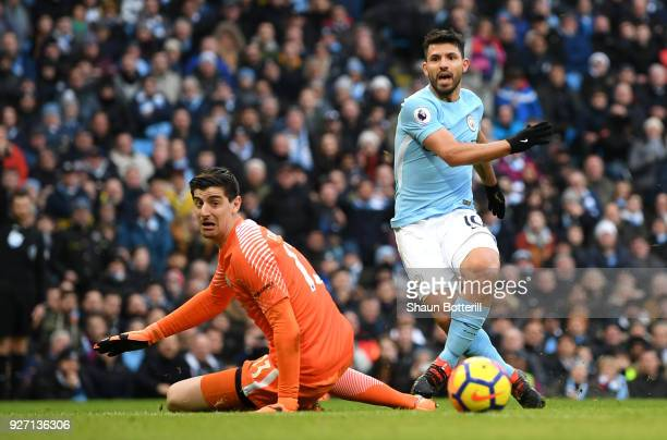 Sergio Aguero of Manchester City shoots and misses past Thibaut Courtois of Chelsea during the Premier League match between Manchester City and...