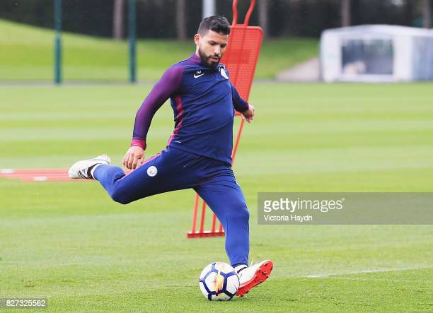 Sergio Aguero of Manchester City shoots during a training session at Etihad Campus on August 7 2017 in Manchester England