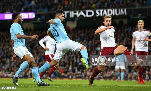 Sergio Aguero of Manchester City shoots during the The Emirates FA Cup Third Round match between Manchester City and Burnley at Etihad Stadium on...