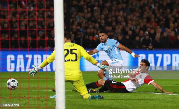 Sergio Aguero of Manchester City shoots during the UEFA Champions League group F match between Feyenoord and Manchester City at Feijenoord Stadion on...