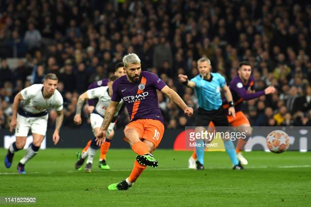 Sergio Aguero of Manchester City shoots from the penalty spot which is then saved by Hugo Lloris of Tottenham Hotspur during the UEFA Champions...