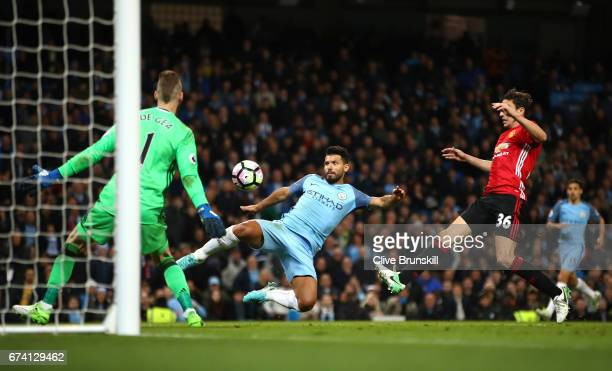 Sergio Aguero of Manchester City shoots on goal during the Premier League match between Manchester City and Manchester United at Etihad Stadium on...