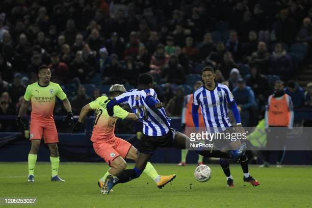 Sergio Aguero of Manchester City shoots past Dominic Iorfa to put them into a 10 lead during the FA Cup Fifth Road match between Sheffield Wednesday...