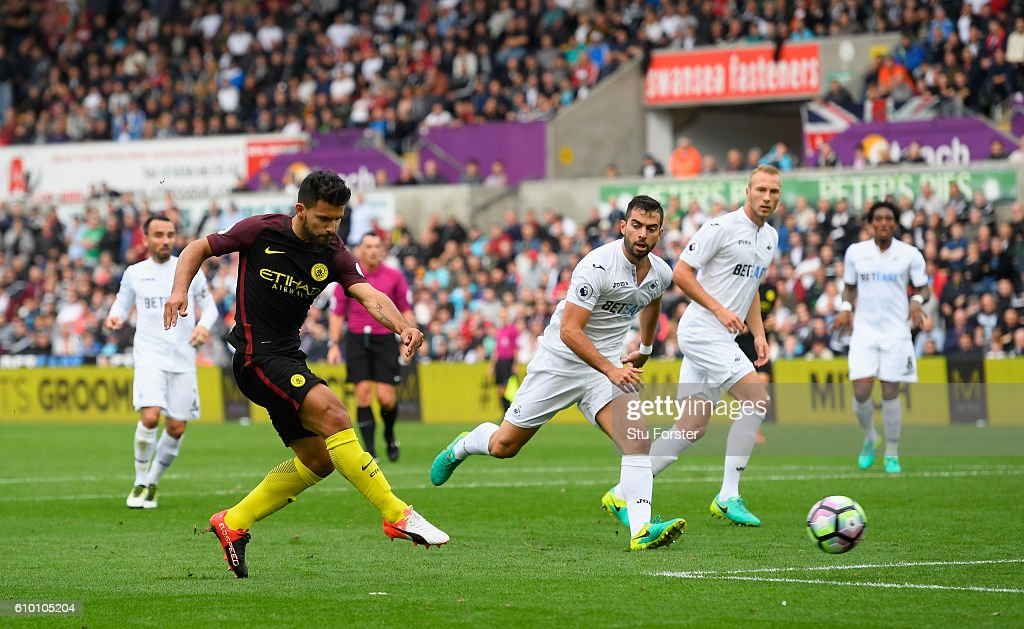 Sergio Aguero of Manchester City shoots to score his sides first goal during the Premier League match between Swansea City and Manchester City at the Liberty Stadium on September 24, 2016 in Swansea, Wales.