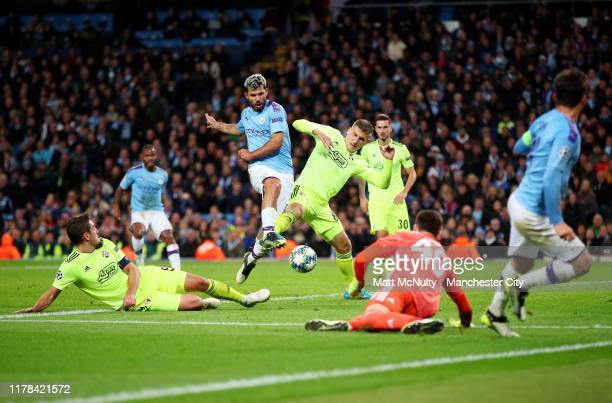 Sergio Aguero of Manchester City shoots under pressure from Emir Dilaver of GNK Dinamo Zagreb during the UEFA Champions League group C match between...
