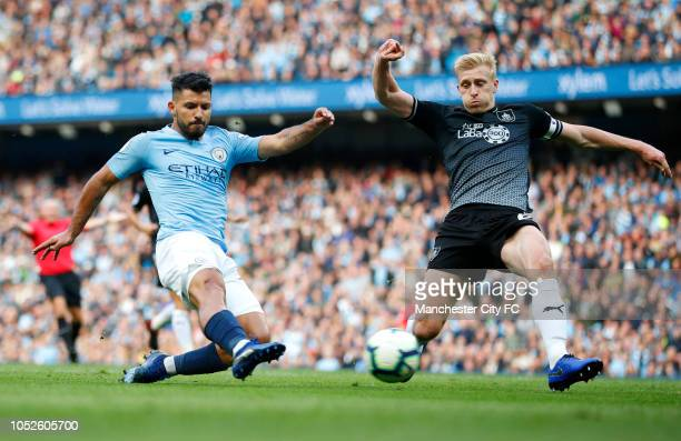 Sergio Aguero of Manchester City shoots while under pressure from Charlie Taylor of Burnley during the Premier League match between Manchester City...