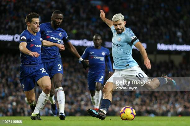 Sergio Aguero of Manchester City shoots while under pressure from Cesar Azpilicueta of Chelsea during the Premier League match between Manchester...