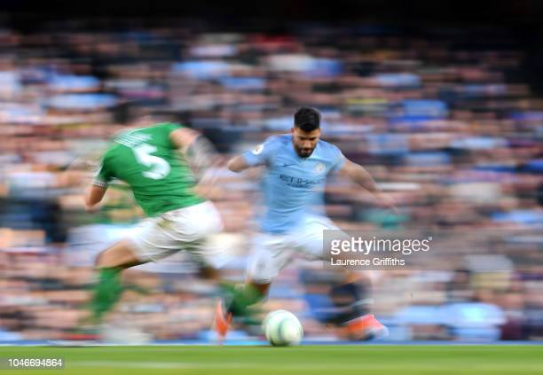 Sergio Aguero of Manchester City skips past Lewis Dunk of Brighton during the Premier League match between Manchester City and Brighton Hove Albion...