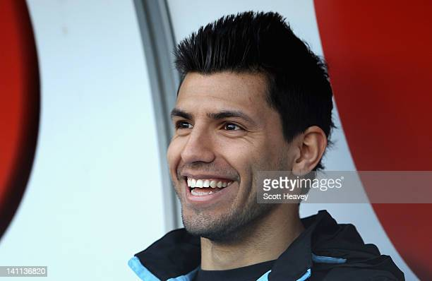 Sergio Aguero of Manchester City smiles ahead of the Barclays Premier League match between Swansea City and Manchester City at the Liberty Stadium on...