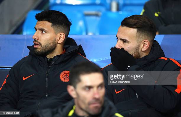 Sergio Aguero of Manchester City speaks to Nicolas Otamendi of Manchester City on the bench prior to kick off during the UEFA Champions League Group...