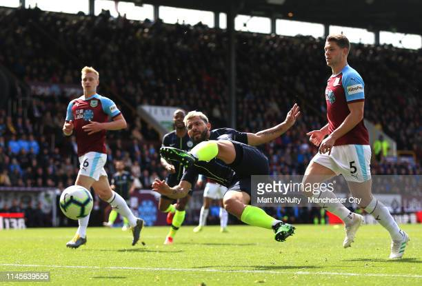 Sergio Aguero of Manchester City stretches for the ball ahead of James Tarkowski of Burnley during the Premier League match between Burnley FC and...