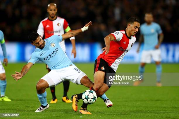 Sergio Aguero of Manchester City tackles Sofyan Amrabat of Feyenoord during the UEFA Champions League group F match between Feyenoord and Manchester...