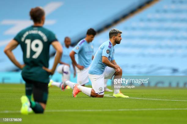 Sergio Aguero of Manchester City takes a knee in support of the Black Lives Matter movement during the Premier League match between Manchester City...