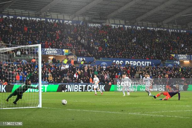 Sergio Aguero of Manchester City takes a penalty kick which rebounds off Kristoffer Nordfeldt of Swansea City for an own goal during the FA Cup...