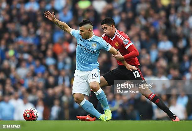 Sergio Aguero of Manchester City takes on Chris Smalling of Manchester United during the Barclays Premier League match between Manchester City and...