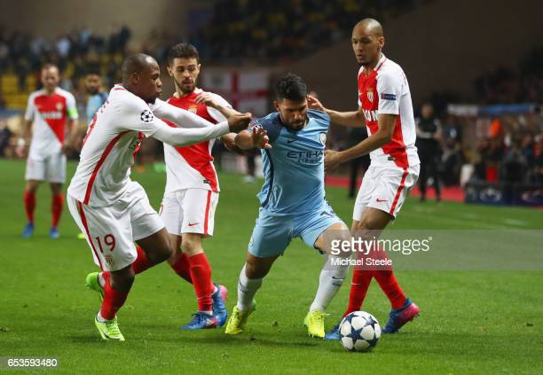 Sergio Aguero of Manchester City takes on Djibril Sidibe, Bernardo Silva and Fabinho of AS Monaco during the UEFA Champions League Round of 16 second...