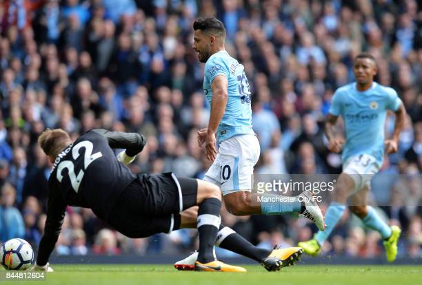 Sergio Aguero of Manchester City takes the ball round Simon Mignolet of Liverpool on the way to scoring his sides first goal during the Premier...