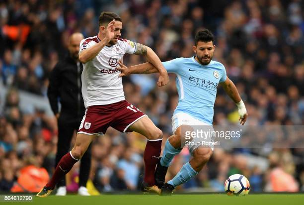 Sergio Aguero of Manchester City tussles with Robbie Brady of Burnley during the Premier League match between Manchester City and Burnley at Etihad...