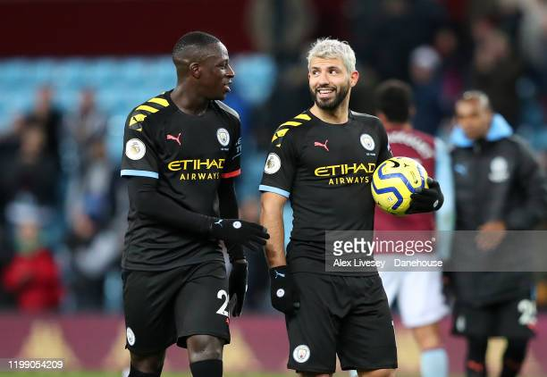 Sergio Aguero of Manchester City walks off with the match ball alongside Benjamin Mendy after scoring a hat-trick during the Premier League match...