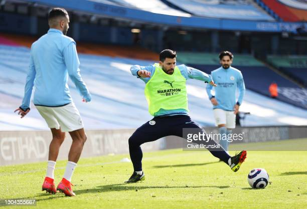 Sergio Aguero of Manchester City warms up prior to the Premier League match between Manchester City and West Ham United at Etihad Stadium on February...