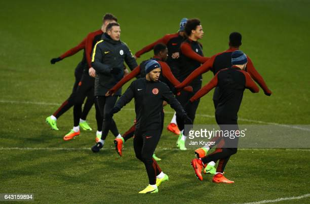 Sergio Aguero of Manchester City warms up with team mates during a Manchester City training session and press conference ahead of their UEFA...