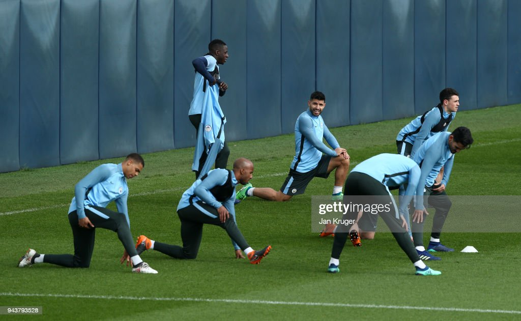 Sergio Aguero of Manchester City warms up with team mates during a training session at Manchester City Football Academy on April 9, 2018 in Manchester, England.