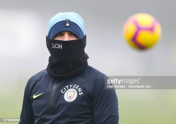 Sergio Aguero of Manchester City wears a snood during the training session at Manchester City Football Academy on January 10 2019 in Manchester...