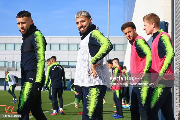 Sergio Aguero of Manchester City winks during the training session at Manchester City Football Academy on February 15 2019 in Manchester England