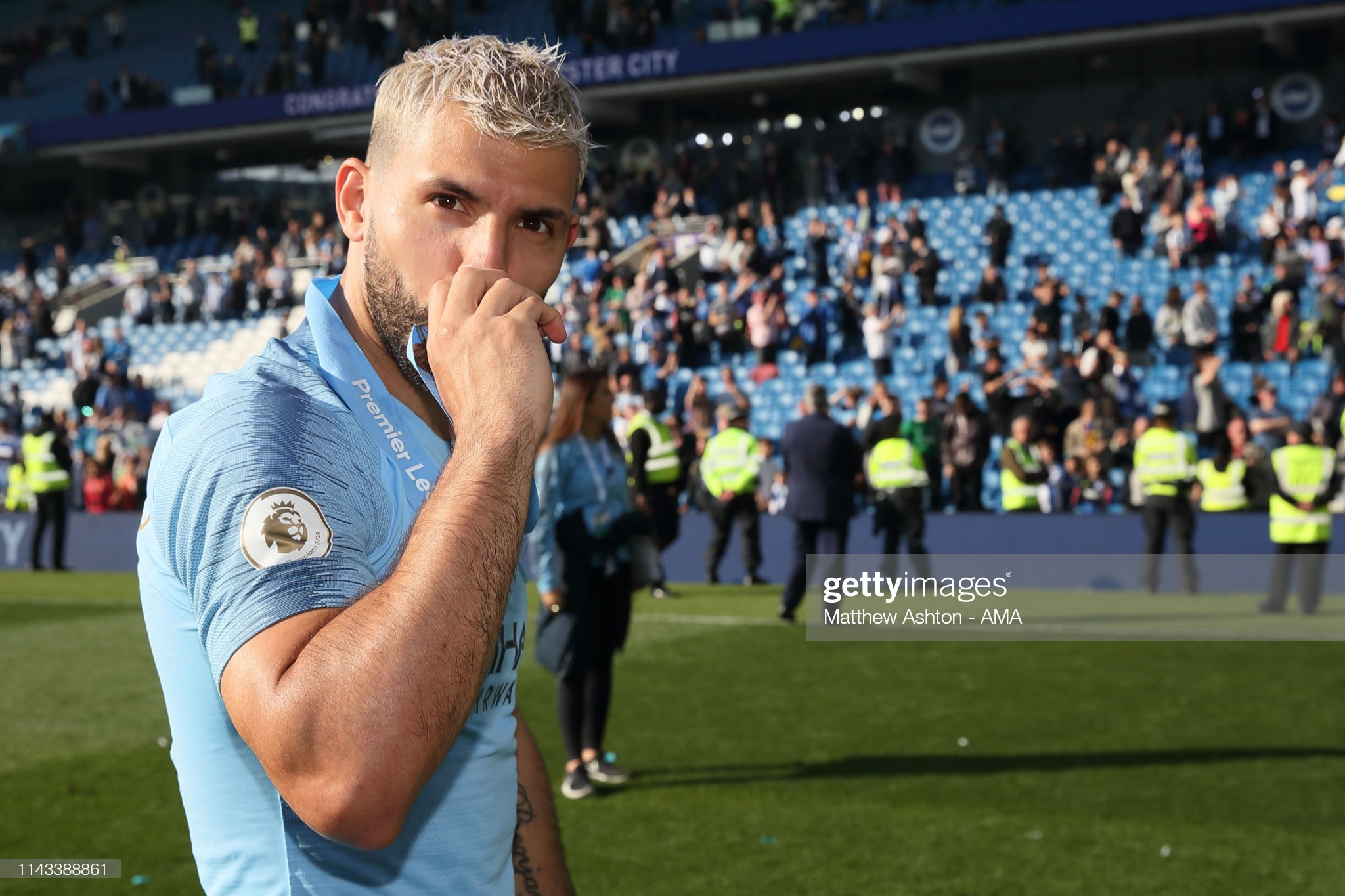 https://media.gettyimages.com/photos/sergio-aguero-of-manchester-city-with-his-winners-medal-during-the-picture-id1143388861?s=2048x2048