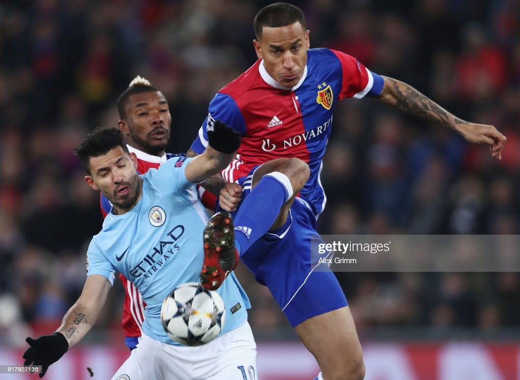 Sergio Aguero (L) of Manchester is challenged by Leo Lacroix of Basel during the UEFA Champions League Round of 16 First Leg match between FC Basel and Manchester City at St. Jakob-Park on February 13, 2018 in Basel, Switzerland.