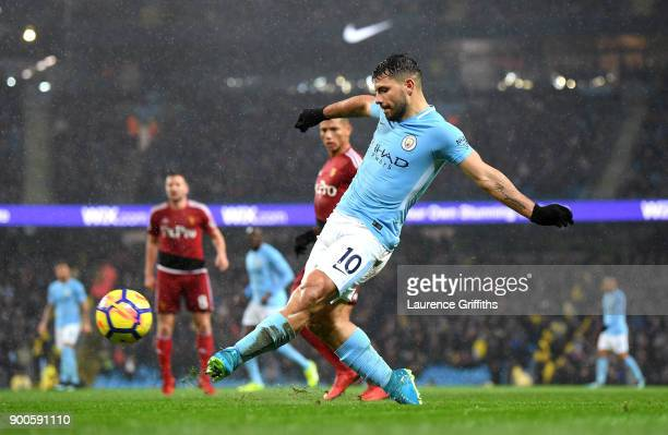Sergio Aguero of Manchestr City shoots during the Premier League match between Manchester City and Watford at Etihad Stadium on January 2 2018 in...