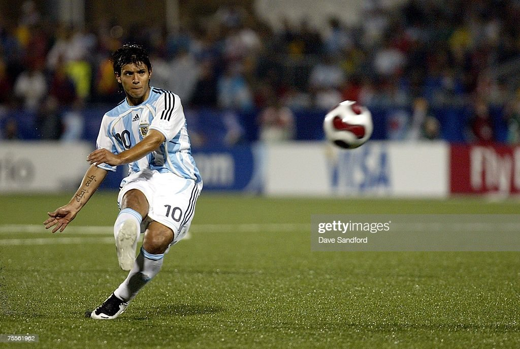 Sergio Aguero #10 of Team Argentina takes a free kick against Team Chile during their FIFA U-19 World Cup Canada 2007 semi-final game at BMO Field on July 19, 2007 in Toronto, Ontario. Argentina won the game 3-0 to advance to the finals.