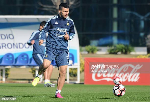 Sergio Aguero plays the ball during a training session at Argentine Football Association 'Julio Humberto Grondona' training camp on May 24 2016 in...