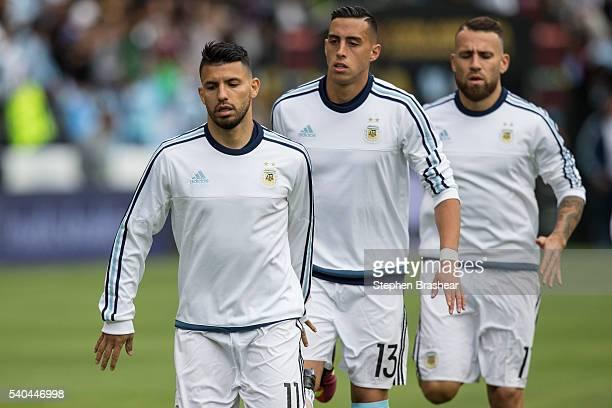 Sergio Aguero Ramiro Funes Mori and Nicolas Otamendi of Argentina warm up before a group D match between Argentina and Bolivia at CenturyLink Field...