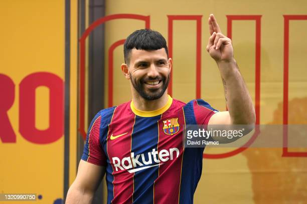 Sergio Aguero reacts as he is presented as a Barcelona player at the Camp Nou Stadium on May 31, 2021 in Barcelona, Spain.