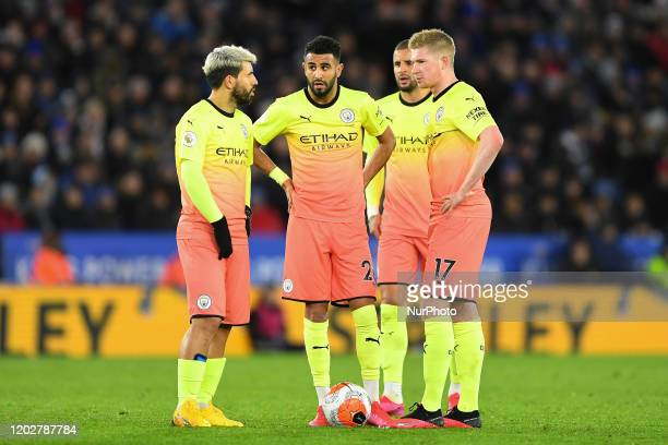Sergio Aguero Riyad Mahrez and Kevin De Bruyne of Manchester City discuss tactics during the Premier League match between Leicester City and...