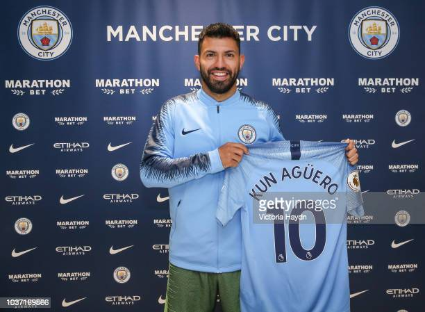 Sergio Aguero signs a contract extension for the club at Manchester City Football Academy on September 21 2018 in Manchester England