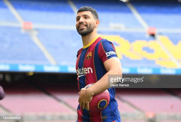 Sergio Aguero smiles as he is presented as a Barcelona player at the Camp Nou Stadium on May 31, 2021 in Barcelona, Spain.