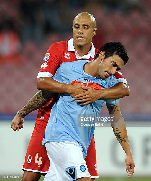 Sergio Almiron of Bari and Ezequiel Lavezzi of Napoli in action during the Serie A match between Napoli and Bari at Stadio San Paolo on September 12...