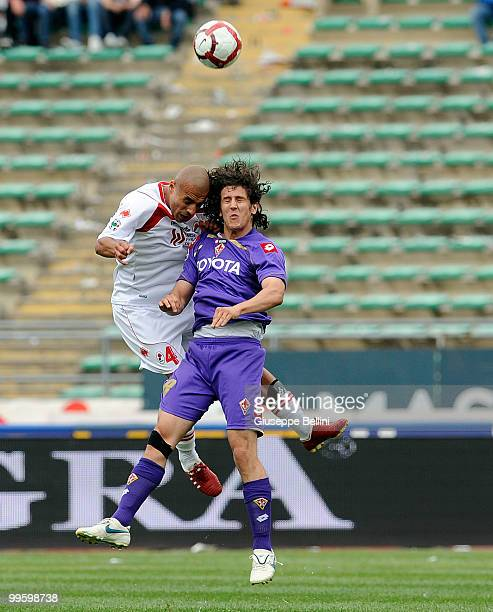 Sergio Almiron of Bari and Stevan Jovetic of Fiorentina in action during the Serie A match between AS Bari and ACF Fiorentina at Stadio San Nicola on...