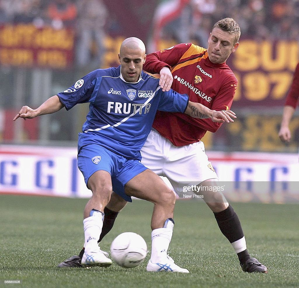 Sergio Almiron of Empoli and Daniele De Rossi of Roma compete for the ball during the Serie A match between AS Roma and Empoli at the Stadio Olimpico on February 19, 2005 in Rome, Italy.