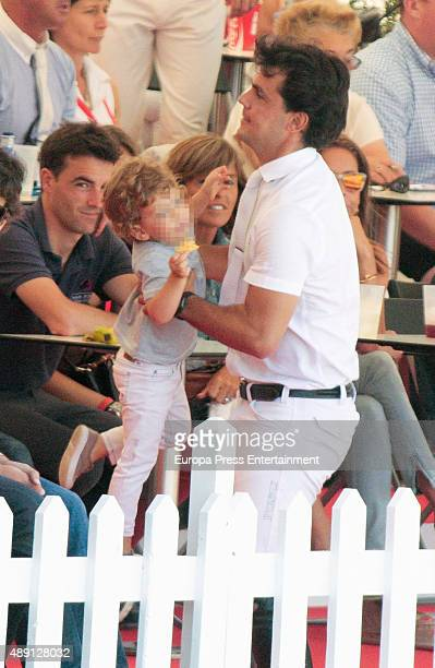 Part of this image has been pixellated to obscure the identity of the child Sergio Alvarez and his son Amancio Alvarez attend 2015 CSIO International...