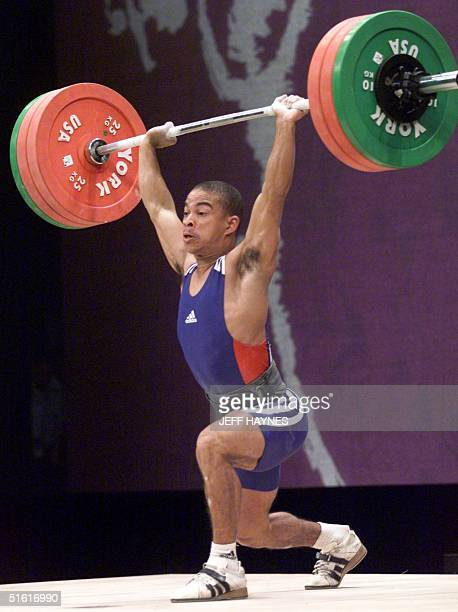 Sergio Alvarez Boulet of Cuba lifts in the clean and jerk competition in the up to 56kg men's weightlifting event during the XIII Pan Am Games 03...
