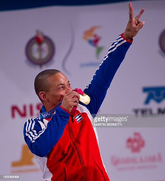 Sergio Alvarez from Cuba celebrates after winning the gold medal in the 56 kg Men Snatch weightlifting competition during the Guadalajara 2011 XVI...