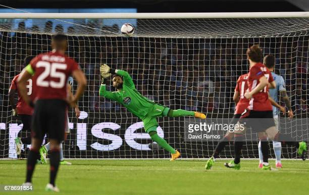 Sergio Alvarez of Celta Vigo fails to stop Marcus Rashford of Manchester United from scoring their first goal during the UEFA Europa League semi...