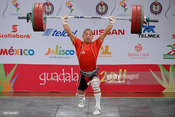 Sergio Alvarez of Cuba competes in the men's 56kg weightlifting during the XVI Pan American Games at Weightlifting Forum on October 23 2011 in...